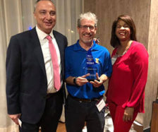 From left are Victor Aimi, the immediate past president for PRSA Greater Fort Lauderdale; Toby Srebnik; and Jennifer Hudson, the incoming chapter president. PHOTO: TRULY NOLEN