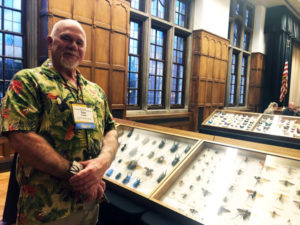 Dave Capps, Capps Pinned Insect Company, stands alongside cases of his personal insect collection at the Purdue Pest Management Conference. PHOTO: HEATHER GOOCH