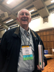 "Dr. Gary Bennet stands proudly as an attendee at the Purdue Pest Management Conference for the first time in decades with his badge that jokingly reads ""Retired Don't Bother Me."" PHOTO: HEATHER GOOCH"