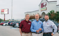 From left, Bobby, Raleigh and Dennis Jenkins stand in front of the Austin, Texas, headquarters of Bobby's company. Photo: Anna Munoz