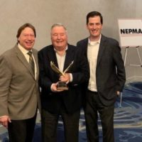 Tony DeJesus (center) is joined by Stephan Goldman, president (left), and Brian Goldman, CEO (right), of Big Blue Bug Solutions located in Providence, R.I. PHOTO: NEPMA