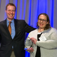 Anna Berry, MS, BCE, receives the Walter Award from CEO Chris McCloud. PHOTO: MCCLOUD SERVICES