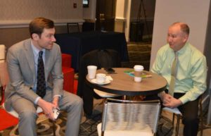 The NPMA's Director of Public Policy Jake Plevelich chats with PestVets' Marty Overline. PHOTO: PMP STAFF
