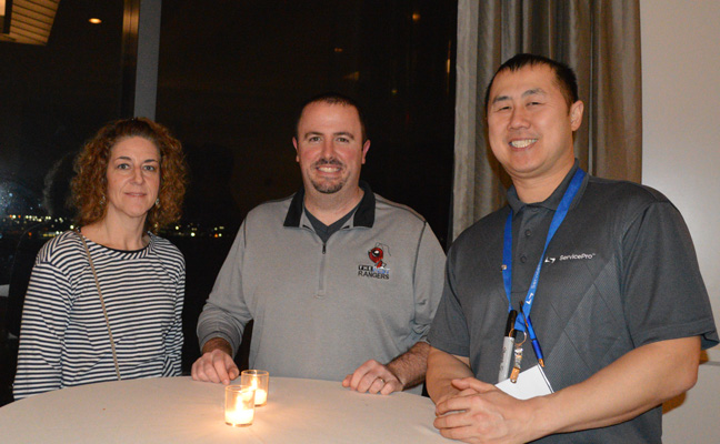 From left, Kendra Snyder of Quest Termite & Pest and Jeff King of The Pest Rangers take a break with ServicePro Director of Sales Ka Tsu. PHOTO: DIANE SOFRANEC/PMP
