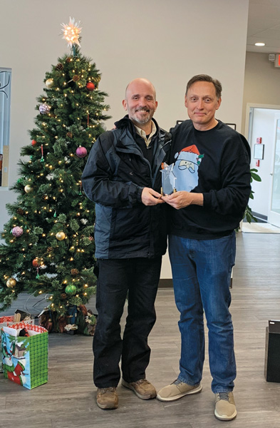 Chris Baumann, left, earned the Schopen Pest Solutions Al Star Award for 2019. PHOTO: PETE SCHOPEN