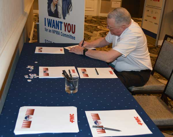 AP&G's Vice President of technical products and services Dr. Stan Cope composes a letter to the troops as part of Operation Gratitude. PHOTO: PMP STAFF