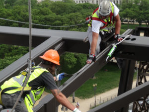 Technicians from Blue Ridge Wildlife & Pest Management lay Bird-Shock electrical track along the National Museum of African American History & Culture in Washington, D.C. PHOTO: BLUE RIDGE WILDLIFE & PEST MANAGEMENT