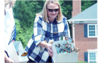 Arrow President and CEO Emily Thomas Kendrick helps release butterflies in a video for Mother's Day. IMAGE: ARROW EXTERMINATORS