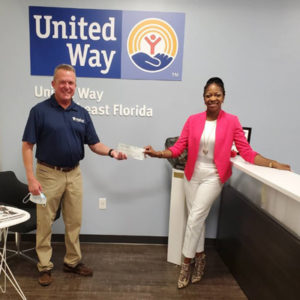 McCall Service CFO David Cooksey presents the donation to Alecia Givens, development manager of United Way of Northeast Florida. IMAGE: MCCALL SERVICE