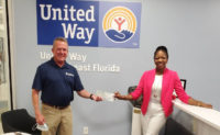 McCall Service CFO David Cooksey presents the donation to Alecia Givens, development manager of United Way of Northeast Florida. IMAGE: KEITH DAVIDSON/MCCALL SERVICE