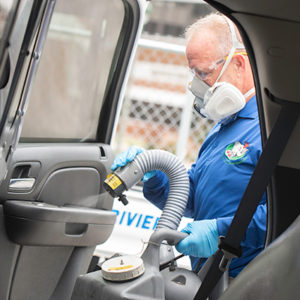 Nozzle Nolen Regional Branch Manager Scott Garver performs the DisMist service on a police cruiser. TRACEY BENSON PHOTOGRAPHY