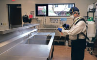 A Truly Nolen technician sanitizes a restaurant sink. PHOTO: GRANT HUNKER/TRULY NOLEN PEST CONTROL