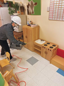 """A B.B.B.K. technician prepares to disinfect children's play furniture at a daycare. PHOTO: """"BUGS"""" BURGER BUG KILLERS"""