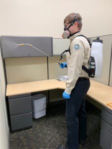 Versacor Total Quality Manager Ryan Gates performs the disinfection service at an office account. PHOTO: VERSACOR ENTERPRISES
