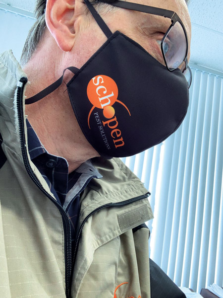 The author models his company-branded mask. PHOTO: PETE SCHOPEN