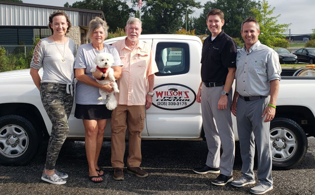From left are Wilson's Pest's Jenny Hughes, Bonnie Gammil (holding Termite Gammil), and Wilson Gammill, with Waynes' Doug Patton and Eric Frye. IMAGE: JENNIFER GRAY/WAYNES PEST CONTROL