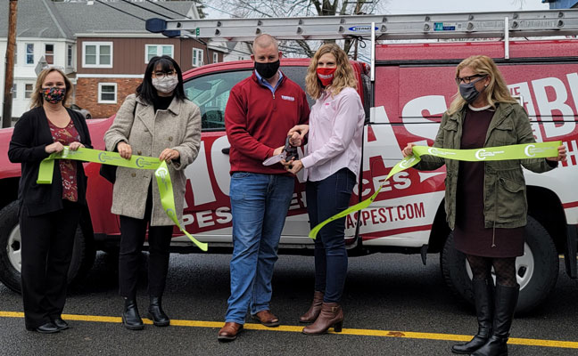 From left, Amy Kneller, Ariana Mattice-Lybrand, Bill Clark, Sarah Thomas-Clark and Kristen Cargill get ready to cut a ribbon and celebrate Thomas Pest Services' 10 years of success in business. PHOTO: THOMAS PEST SERVICES