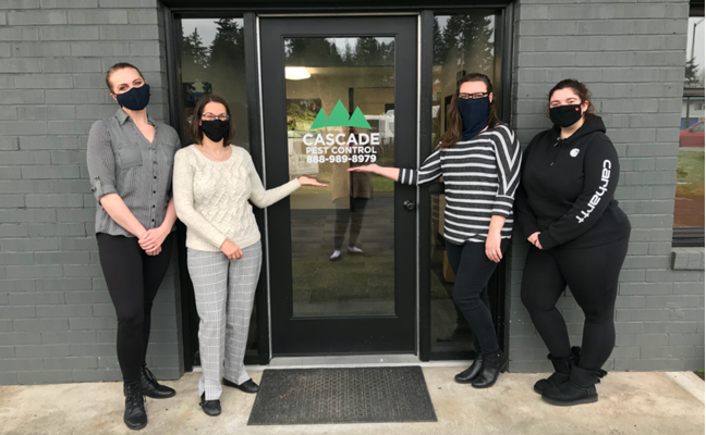 Cascade Pest Control employees at the entrance of the new office. From left are: Bailey Luder, Amy Houston, Brittney Knauts, Kristin Miller. PHOTO: LORA PETERSON, CASCADE PEST CONTROL