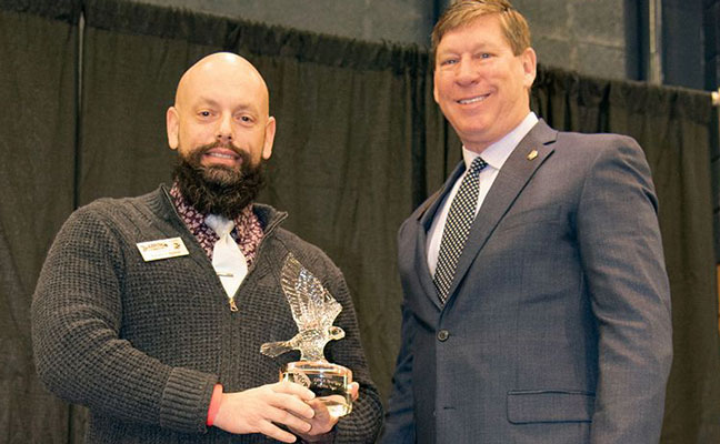 Arrow's Xavier Cugnon, left, receives the PestVets award from GPCA President Brantley Russell. IMAGE: ARROW EXTERMINATORS