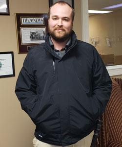 Jason Heiser, senior service team lead for Sherrill Pest Control, models the new three-in-one jacket. PHOTO: SHERRILL PEST CONTROL