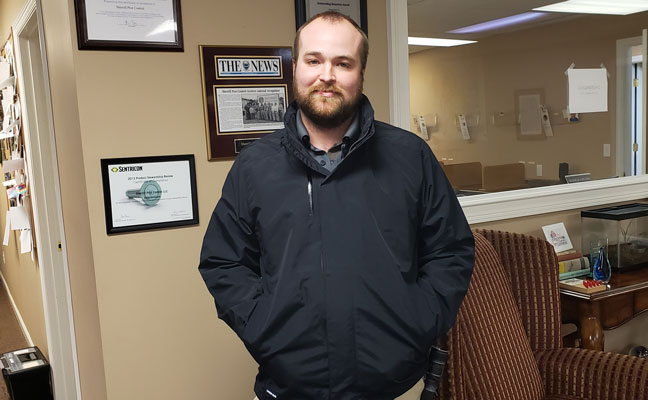 Jason Heiser, senior service team lead for Sherrill Pest Control, models the new three-in-one jacket. PHOTO: SHERRILL PEST CONTROL