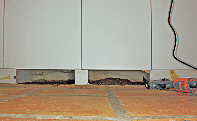 Removing a cabinet kickboard can reveal extensive pet food debris, aka a food source for mice and stored product pests. PHOTO: MARK VANDERWERP