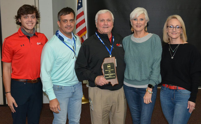 From left are Tripp Brewer (Gordon's grandson and fourth-generation PMP), Redd VP Eddie Brewer, Gordon Redd and his wife, Donna, and their daughter Bevin Brewer (Redd's marketing director and third-generation PMP). PHOTO: REDD PEST SOLUTIONS