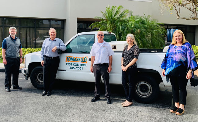 From left are Arrow's Tim Pollard and Kevin Burns, Chuck and Tracy Doll of Tomasello, and Arrow's Emily Thomas Kendrick. PHOTO: ARROW EXTERMINATING
