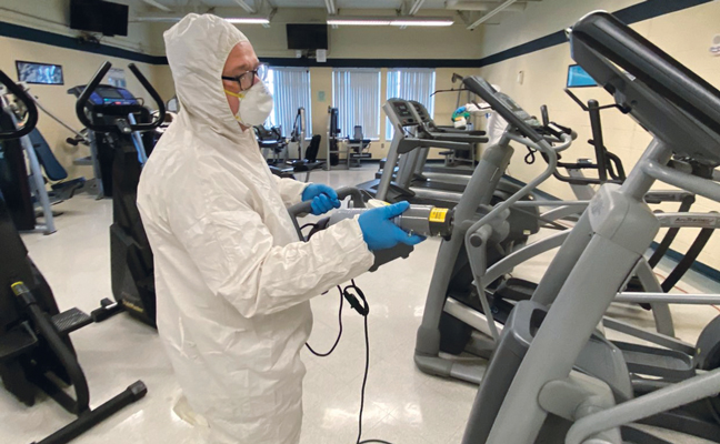 Quest Termite & Pest Solutions' Chris Snyder has taken on new clients, like this gym, thanks to the disinfection service offering. PHOTO: QUEST TERMITE & PEST SOLUTIONS