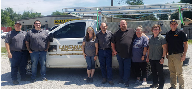 From left are Langman's technicians Michael Lyday and Michael Powell, office staffer Jessica Stewart, technician Jason Powell and co-owners Will and Dianne Langman. Next to them are Plunkett's president, Stacy O'Reilly, and wildlife manager, Jared Miller. PHOTO: PLUNKETT'S PEST CONTROL