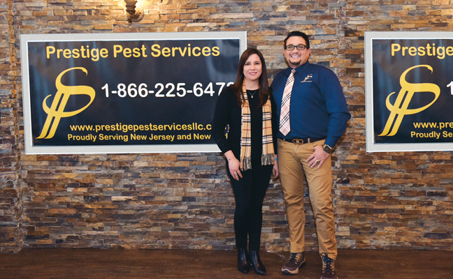 Karol and Favio Ulloa pose inside their PPS headquarters building in Hawthone, N.J. PHOTO: PRESTIGE PEST SERVICES