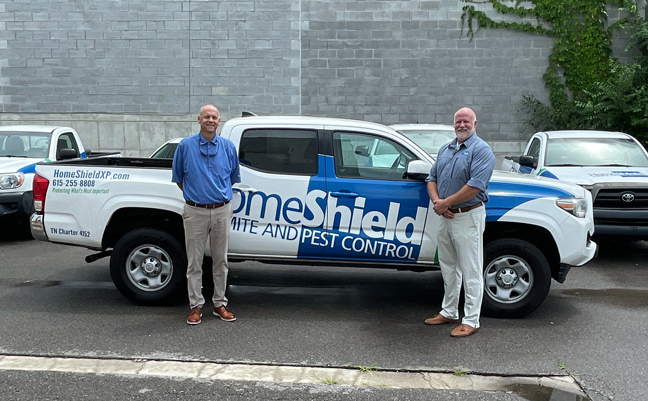 From left are Shawn Hollis, President of Waynes and Chris Eby, Owner of HomeShield. PHOTO: WAYNES PEST CONTROL
