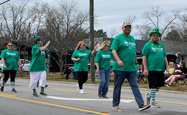 In addition to having a work vehicle in this year's St. Patrick's Day parade, members of the Modern Exterminating Co. team also walked the parade route. PHOTO: MODERN EXTERMINATING CO.