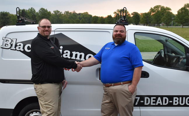 Director of Business Expansion Travis Donaldson (right) congratulates Branch Operations Manager Brian Thornton (left) on opening Black Diamond's newest branch location in Knoxville. PHOTO: BLACK DIAMOND PEST CONTROL